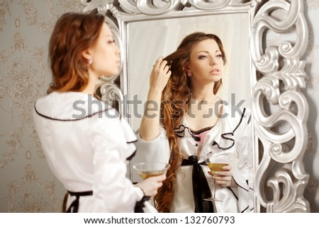 Beauty woman with long hair and mirror - stock photo