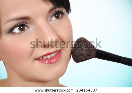 Beauty woman with makeup brush, close up - stock photo