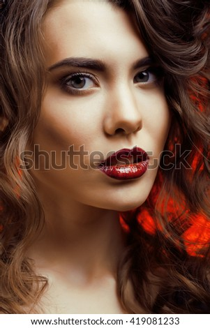 Beauty Woman with Perfect Makeup Beautiful Professional Holiday Make-up. Red Lips and Nails Beauty Girls Face isolated on Black background Glamorous Woman - stock photo
