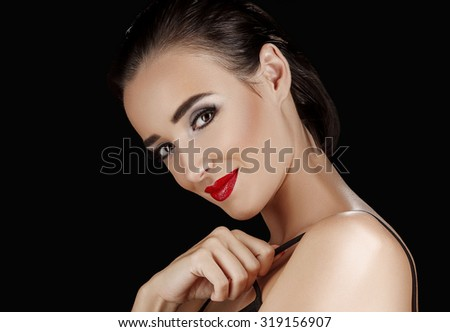 Beauty Woman with Perfect Makeup. Beautiful Professional Holiday Make-up. Red Pink Lips and Nails. Beauty Girl's Face isolated on Black background - stock photo