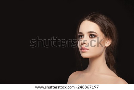 Beauty Woman with Perfect Makeup. Beautiful Professional  Make-up. . Beauty Girl's Face isolated on Black background. Glamorous Woman - stock photo