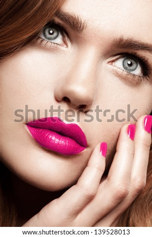 Beauty Woman with Perfect Makeup. Pink Lips and Nails. Beautiful Professional Holiday Makeup. - stock photo