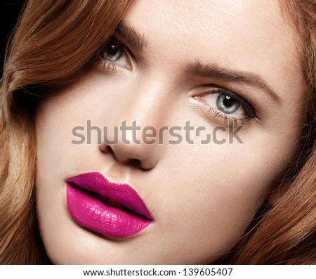 Beauty Woman with Perfect Makeup. Pink Lips and Nails.  Closeup portrait of young lady - stock photo