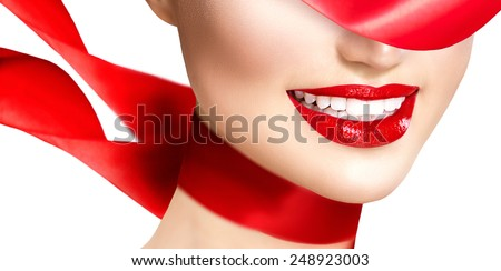 Beauty woman with perfect smile. Beautiful Model Girl with red lips and blowing red silk scarf isolated on white background. Teeth whitening. Holiday make up, perfect skin - stock photo