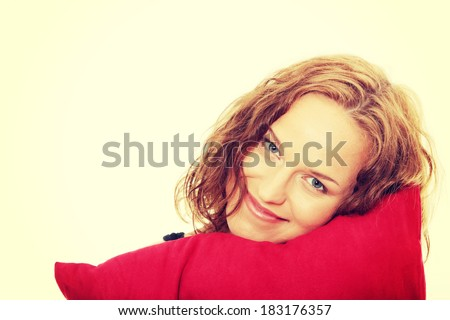 Beauty woman with red pillow - stock photo