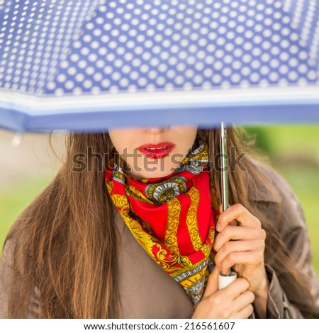 Beauty woman with umbrella. focus on lips - stock photo