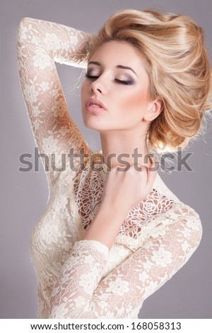 Beauty woman with wedding hairstyle and makeup. Bride fashion. Jewelry and Beauty. Woman in white dress,perfect skin, blond hair. Girl with stylish haircut. Skincare. - stock photo