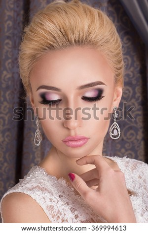 Beauty woman with wedding hairstyle and makeup. Bride fashion. Jewelry and Beauty. Woman in white dress, perfect skin, blond hair. Girl with stylish haircut. .Wedding decoration. - stock photo