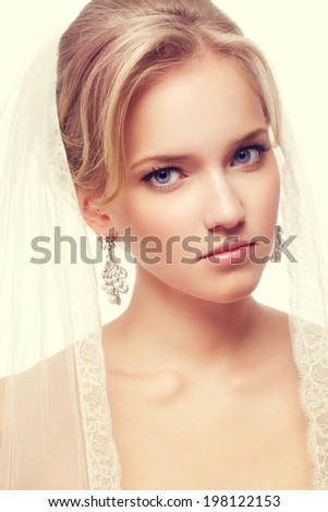 Beauty woman with wedding hairstyle and makeup. Bride fashion. Jewelry and Beauty. Woman with perfect skin, blond hair. Girl with stylish haircut. - stock photo