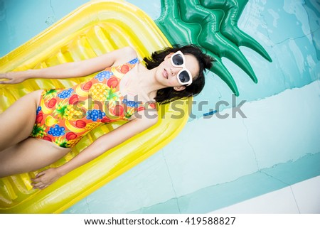 beauty women with sunglasses and pool toy in summer  - stock photo