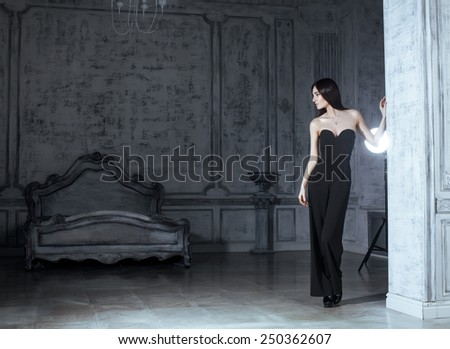 beauty young brunette woman in luxury home interior, fairy bedroom grey stylish - stock photo
