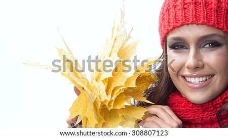 beauty young caucasian woman brunette in warm colorful clothing  with yellow autumn maple leaves smiling happy toothy smile face isolated on white studio shot - stock photo
