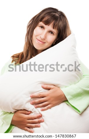 Beauty young smiling caucasian woman hand holding pillow for rest and sleep white isolated - stock photo