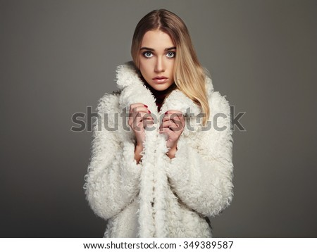 beauty young woman in winter fashion wearing a fur.beautiful blond hair model girl - stock photo