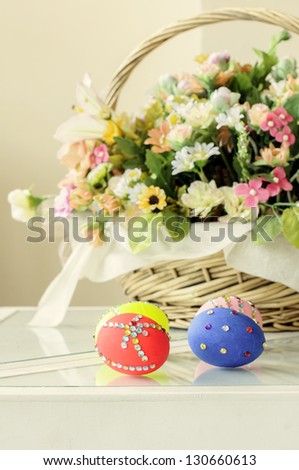 beautyful easter egg with colorful flower in basket - stock photo