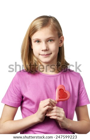 Beautyful girl with lollipop hearts isolated - stock photo