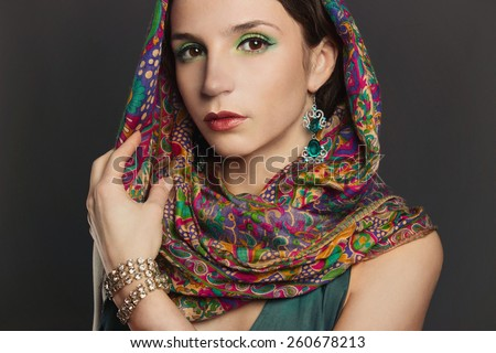 beautyful young brunette woman in scarf.fashionable girl with accesories. arabian slyle - stock photo