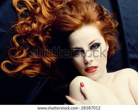 Beauutiful young woman with red hair - stock photo