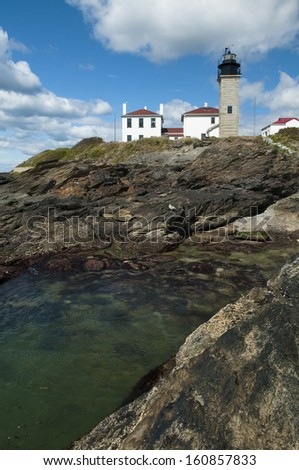 Beavertail Lighthouse is Connecticut's second oldest lighthouse, enjoyed by many tourists. - stock photo