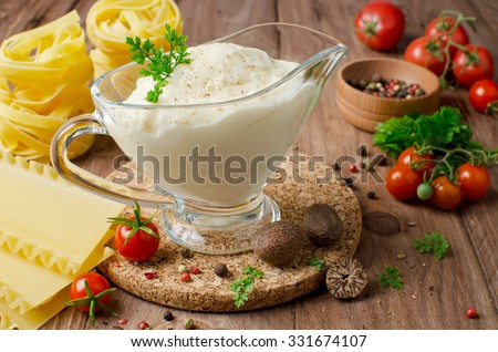 Bechamel sauce for traditional European dishes - stock photo