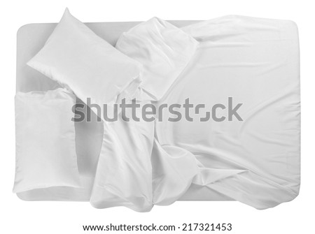 Bed covered with bed spreads and soft pillow. - stock photo