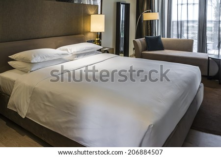 Bed in a business hotel room. - stock photo