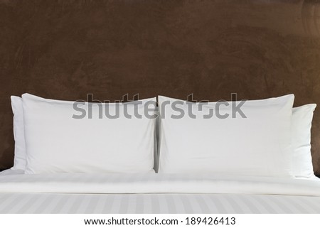 Bed in a hotel room at night - stock photo