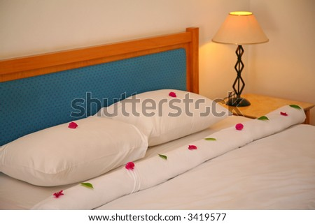 Bed in hotel - stock photo