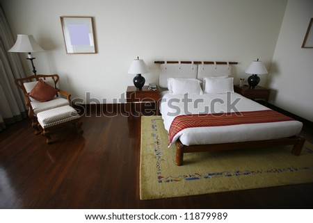 bed in luxury hotel - stock photo