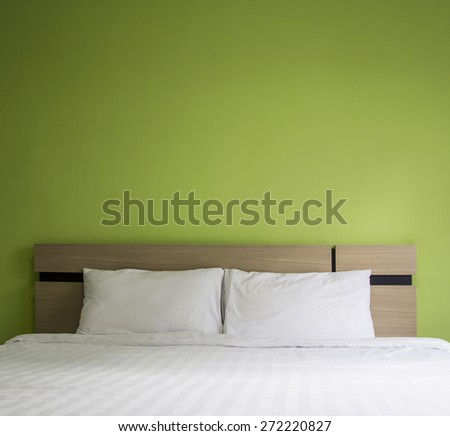 Bed in the bedroom - stock photo