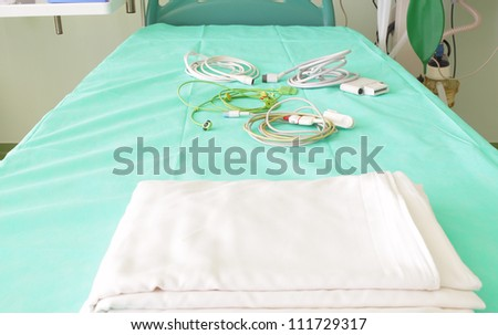 bed in the hospital waiting for the patient. - stock photo