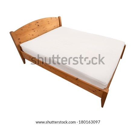 Bed isolated with wood frame - stock photo