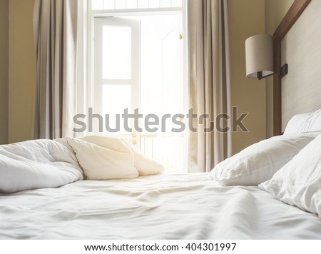 Bed Mattress and Pillows Mess up Bedroom in the morning - stock photo