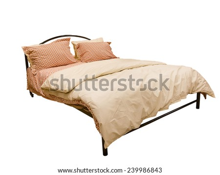 Bed with duvet and cushions isolated on white background - stock photo