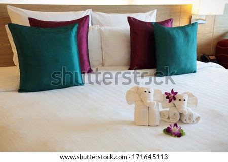 bed with pieces of towels in a hotel in Thailand - stock photo