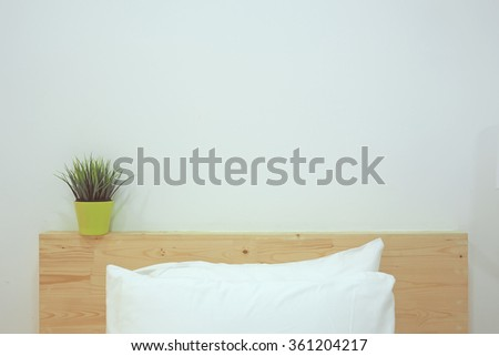 Bed with white linen and pillows. Minimalism Interior. - stock photo