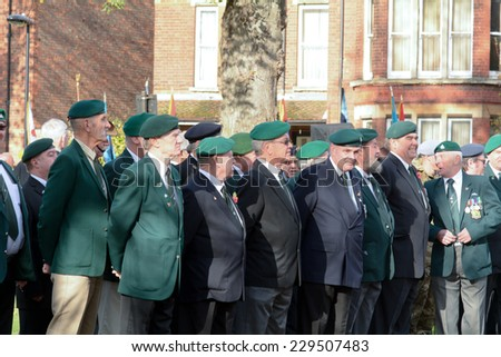 BEDFORD, ENGLAND  NOVEMBER 2014: Remembrance Day Parade - Veterans paying their respects to their fallen comrades, shown on 9 November 2014 in Bedford - stock photo