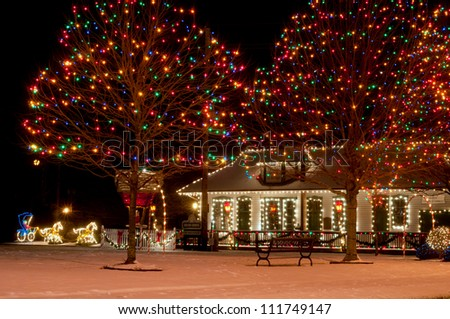 BEDFORD, OH - DECEMBER 28: The historic old Wheeling and Lake Erie Railroad Depot on the village commons is festively lit up for Christmas on December 28, 2011, in Bedford, Ohio. - stock photo