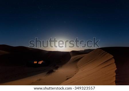 Bedouin nomad tent camp in Merzouga dunes, Morocco - stock photo