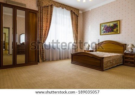 Bedroom classicism brown interior with paint on the wall - stock photo
