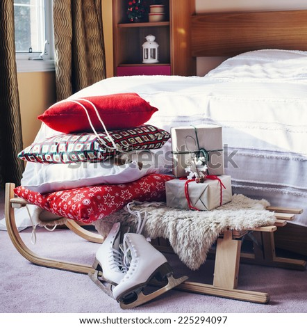 Bedroom decorated in Christmas style. - stock photo