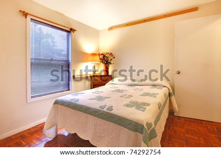 Bedroom in a garden house with one queen size bed. - stock photo