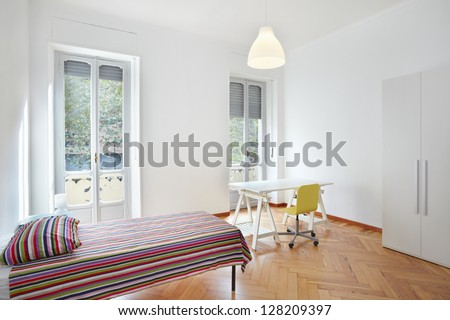 Bedroom in modern apartment - stock photo