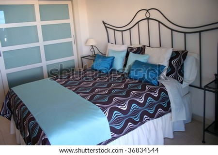 Bedroom in the apartment on Tenerife island - stock photo