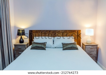 Bedroom interior design with furnishings with copy space on the wall - stock photo