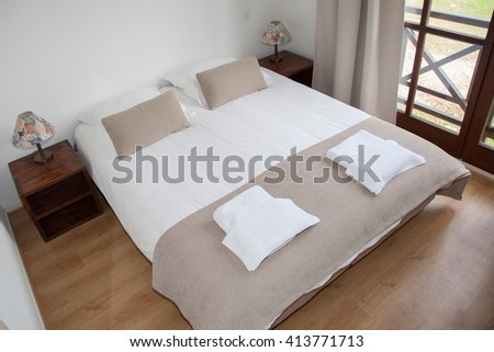 Bedroom interior in a beautiful bright house - stock photo