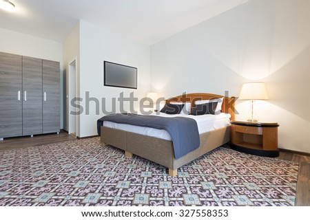Bedroom interior in the evening - stock photo