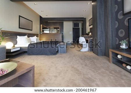 Bedroom interior with jacuzzi bath near the bed - stock photo