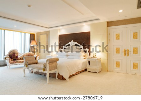 bedroom of luxury suite in hotel - stock photo