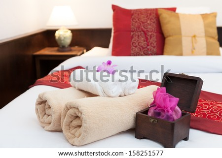 Bedroom ready for guests in soft warm lighting - stock photo